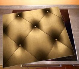 Bild von einer Herdabdeckplatte aus Glas in Lederoptik in gold
